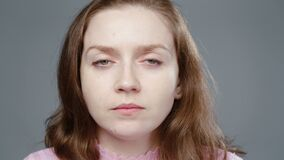 Video of young woman in pink turtleneck with insight, portrait