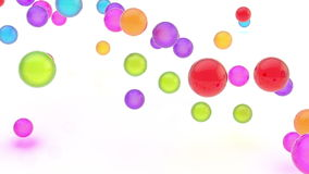 Videoanimatie van glanzende kleurrijke dalende orbs stock videobeelden