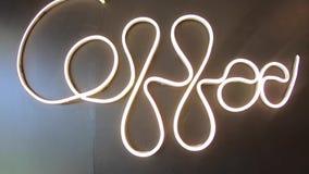 """Videoaufnahmen """"Coffee """"Words geschrieben mit Neonlichtern auf einen schwarzen Wandhintergrund stock video footage"""