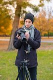 The videoblogger adjusts his camera. Front view Royalty Free Stock Images