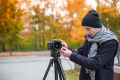 The videoblogger adjusts his camera Stock Images