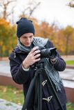 The videoblogger adjusts his camera Stock Photography