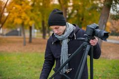 The videoblogger adjusts his camera Royalty Free Stock Photo