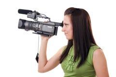 Videocámara y muchacha Fotografía de archivo