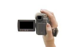 Videocámera en una mano femenina Imágenes de archivo libres de regalías