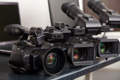 Videocamera. Three professional digital video cameras Stock Photography