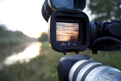 A videocamera filming river Royalty Free Stock Photo