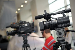 Videocamera and journalists Stock Images