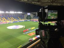 Videocamera ready for live transmisision for television of football game without fans stock image
