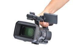 Videocamera in una mano fotografie stock