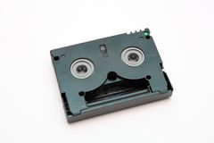 Videocassette. Magnetic tape is black for a compact camcorder Royalty Free Stock Photography