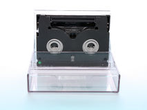 Videocassette. Magnetic tape is black for a compact camcorder Stock Photography