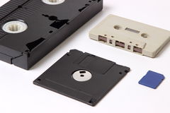 Videocassette, audio cassette, computer diskette and flash drive Royalty Free Stock Photography