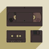 Videocassette, compact cassette and floppy disk. Retro storage devices. Outdated technology concept Stock Photography