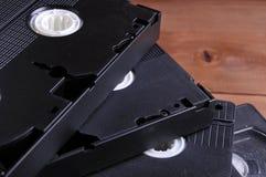 Videocintas viejas en la tabla imagen de archivo