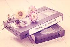 Videocintas viejas y flores secas Fotos teñidas Imágenes de archivo libres de regalías