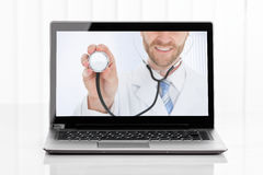 Videoconferencing With Doctor On Laptop Stock Photo