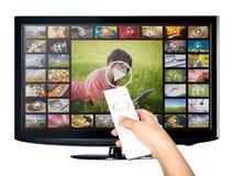 Videoen på - begära VOD service på TV Royaltyfria Foton