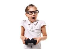 Videogame novo do jogo da menina pelo gamepad Imagens de Stock Royalty Free