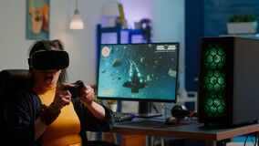 Free Videogame Player With Vr Goggles Raising Hands After Winning Space Shooter Royalty Free Stock Photos - 215669858