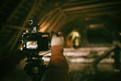 Videographer работает на отчете Стоковое Изображение
