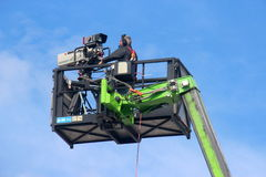 Videographer on crane basket Royalty Free Stock Photo