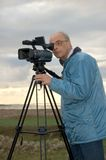 videographer del treppiedi Fotografie Stock Libere da Diritti