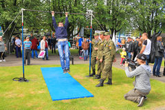 Videographer filmed as a soldier performs an exercise on the bar Royalty Free Stock Photography