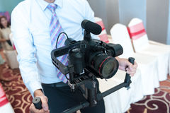 Videographer with gimball video slr,videographer using steadycam Royalty Free Stock Images