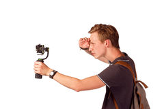 Videographer holds mobile camera on gimbal. Isolated on white Royalty Free Stock Images