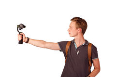 Videographer holds mobile camera on gimbal. Isolated on white Stock Photo