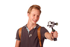 Videographer holds mobile camera on gimbal. Isolated on white Stock Image