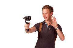 Videographer holds mobile camera on gimbal. Isolated on white Stock Photography