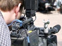 Videographer/homem da câmera Fotografia de Stock Royalty Free