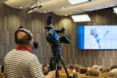 Videographer makes online broadcast at the conference. Moscow, Russia - September 2, 2016: Videographer makes online broadcast at the conference Stock Images