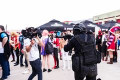 Videographer making a video with gunmen cosplayers Stock Photography