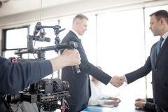 Free Videographer Making Video Of Business People Stock Photo - 99642690