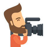 Videographer mit seiner Video-Camcorder Stockfotos