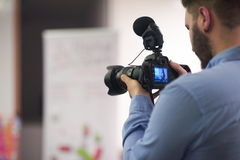 Videographer recording on conference Royalty Free Stock Photos