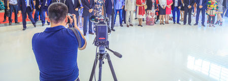 Videographer shoots with a digital camera business meeting. Videographer shoots with a digital camera Stock Photos