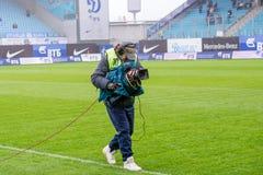 Videographer sul gioco di calcio Fotografia Stock