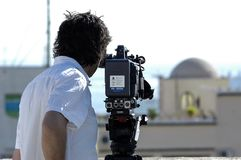 Free Videographer With Tripod Camera In Documentary Film Shooting Stock Photos - 166129873