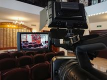 Videography in the interior. Digital video camera with LCD display. Led on-camera light.  stock image