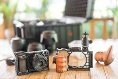 Videography Production prepare equipment for work with mirrorless camera, cage. Wooden grip and ball head on the table stock photos