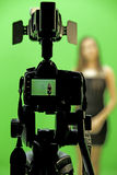 Videography. Video camera lady people green black blurry Royalty Free Stock Image