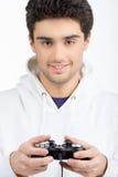 Videojugador con la palanca de mando. Fotografía de archivo libre de regalías