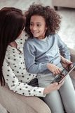 Attractive nice mother watching a video with a daughter royalty free stock photos
