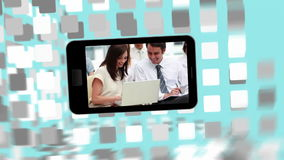 Videos of business people using computers on a smartphone screen Stock Photography