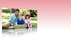 Videos of families using the internet in a park stock footage