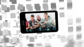 Videos of a family in living room on a smartphone screen stock footage